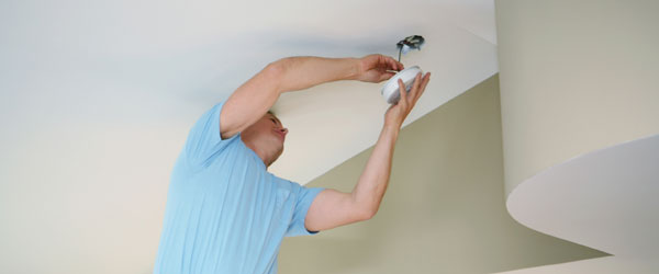 Pleasanton Electrician installing wired smoke detector