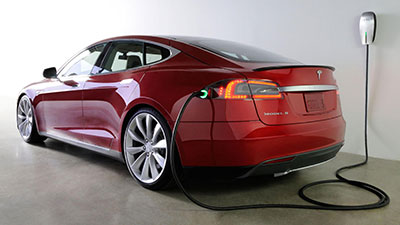 Electric vehicle charger refuels Tesla Model S electric car